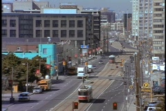 Trolleys move down a Toronto street. Stock Footage