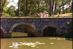 Four people cross a bridge in Hue, Vietnam. Stock Footage