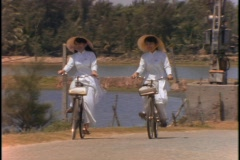 Vietnamese students ride bicycles. - stock footage