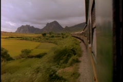 A train speeds through the Vietnamese countryside. Stock Footage