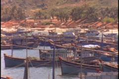 Boats sit in dock in a Vietnamese fishing village. Stock Footage