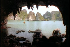 Fishing boats sit in a cave in the South China Sea. Stock Footage
