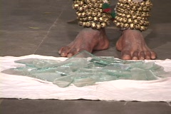 A bare-foot mystic steps on broken glass. Stock Footage