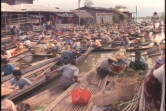 Many boats float in a large market on Inle Lake, Myanmar. Stock Footage