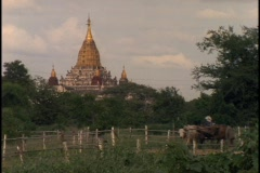 An ancient Buddhist temple juts up from the horizon in Burma. Stock Footage