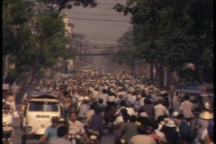 Bicycle traffic fills up the streets in Saigon. - stock footage