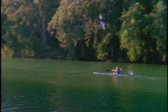 A woman kayaks down a river. Stock Footage