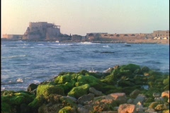 The sea crashes against the shore near ancient Roman ruins. Stock Footage