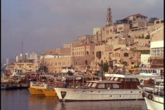 Boats float at the Jaffa, Israel port. Stock Footage