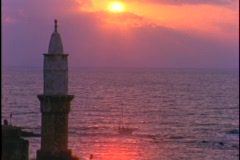The sun sinks low over a mosque in Jaffa. Stock Footage