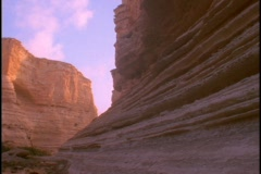 A cliff face jets upward from a desert. Stock Footage