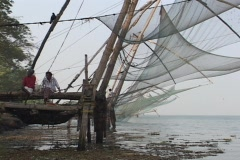 Fishing nets hang along a dock in Kerala, India - stock footage
