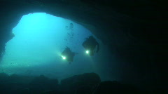 Divers in the cave - stock footage