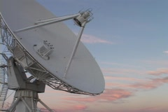A satellite dish slowly moves before a colorful sky in New Mexico. Stock Footage