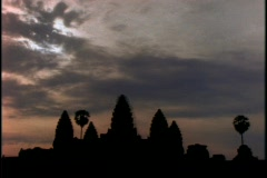 Sunlight tries to break through the clouds over Angkor Wat temple in Cambodia Stock Footage