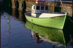 A fishing boat floats near a dock. Stock Footage