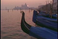 Gondolas lie moored in a Venice harbor. Stock Footage