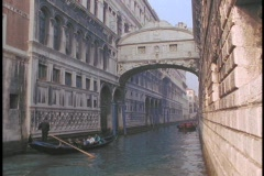 A gondola sails under the Bridge of Sighs in Venice, Italy. Stock Footage