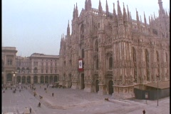 Pedestrians walk near the Duomo Cathedral in Milan, Italy. Stock Footage