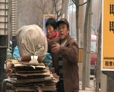 Chinese people recycling cardboard  in beijing china. - stock footage
