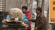 Stock Video Footage of  Chinese people recycling cardboard  in beijing china.