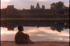 The Angkor Wat Temple reflects in a pond. Stock Footage
