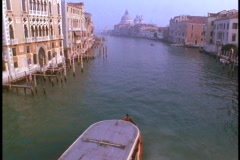 A riverboat floats down the Venice canals. Stock Footage