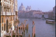A ferryboat crosses a canal in Venice. Stock Footage