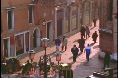 Pedestrians walk along a lane in Venice. Stock Footage