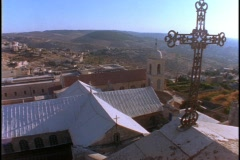 A cross adorns the roof of the Church Of the Nativity in Bethlehem. - stock footage