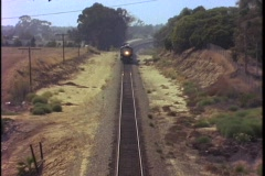 A steam train passes through a countryside. Stock Footage