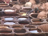 Workers dye leather in ancient pots. Stock Footage