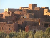 Adobe buildings crowd close together on a hillside. Stock Footage