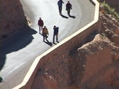 Hikers walk up a very steep, winding canyon trail. Stock Footage