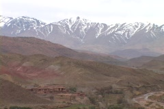 Snow capped mountains tower over rugged valleys. Stock Footage