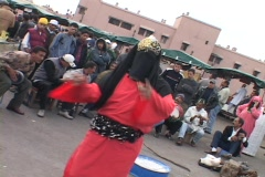 A person in traditional Islamic clothing dances for a crowd. Stock Footage