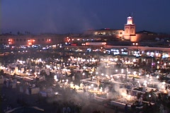 Smoke rises from food stalls at a night-time market in Marrakesh Morocco. Stock Footage