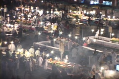 A busy outdoor cooking market comes to life at night in Marrakesh Morocco. Stock Footage