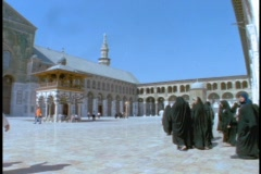 Muslim worshipers walk inside a Mosque in Syria. Stock Footage