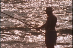 A fisherman checks his line. Stock Footage