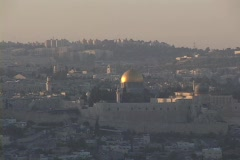 The gold Dome of the Rock glows in the middle distance in the Old City Stock Footage