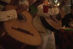A mariachi band strums their rhythmic guitar music in a restaurant. Stock Footage