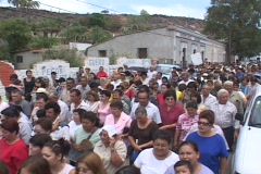 Crowds of people walking through small Mexico village, during a religious Stock Footage