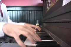 A man's hands dance across the keyboard of a ragtime piano. Stock Footage