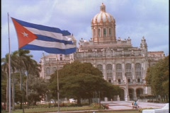 The Cuban flag waves outside the capital building in Cuba, Havana. Stock Footage