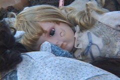 A child's doll lies in the rubble of a house after Hurricane Katrina. Stock Footage