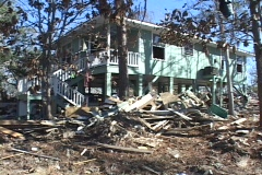 A damaged building stands amidst the rubble due to Hurricane Katrina. Stock Footage