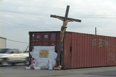 A small shrine adorns a storage bin for St. Bernard Parish following Hurricane Stock Footage