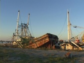 Stock Video Footage of Ruined boats and ships show the destruction caused by Hurricane Katrina.