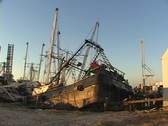 Stock Video Footage of A mass of rubble shows what is left of fishing boats after Hurricane Katrina.